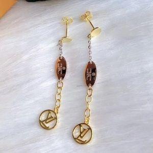 L V earrings